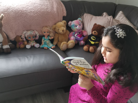 Sarah (2VB) reading Toby and the Great Fire of London to her toys and Mum