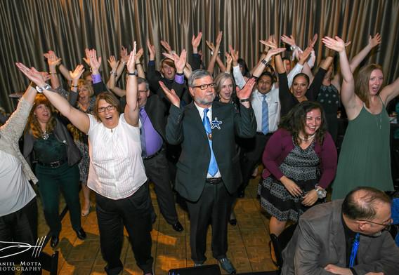 everyone's raising hands at party