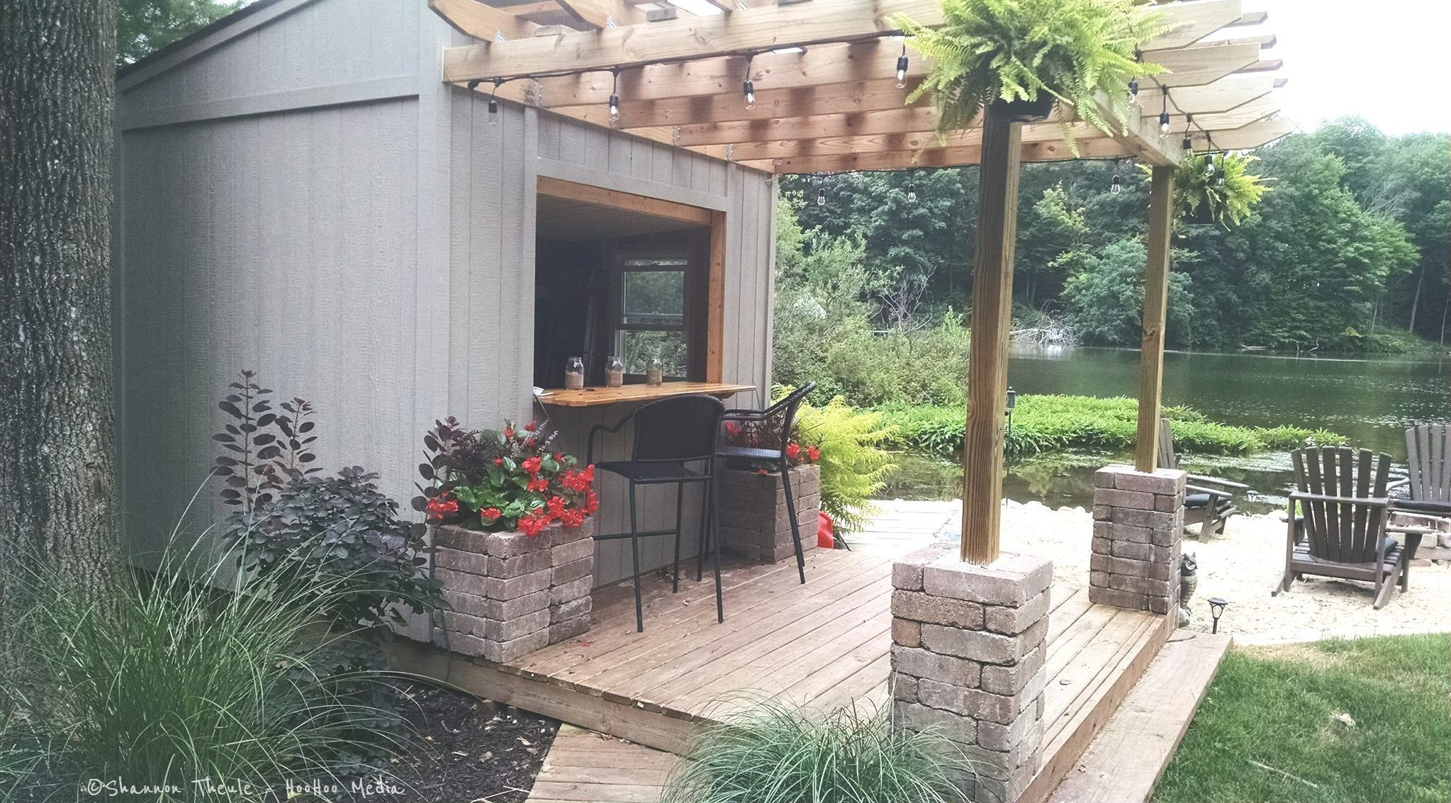 Custom shed/bar, pergola on deck.