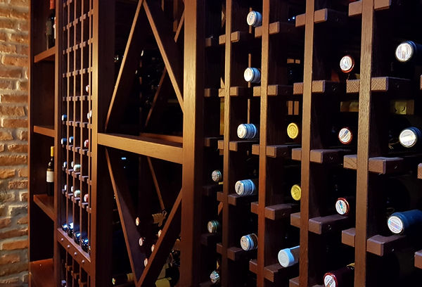 wine-bottles-in-a-large-wooden-wine-rack