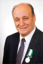 Memorial - Schumacher's Lou Battochio