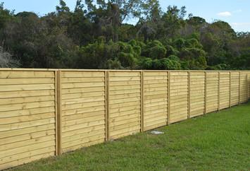 Ship Lap Wood Fence Panels, Toe nailed with cap.