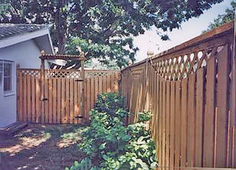 Vertical Shadow Box Wood Fence Panels with Deep Scoop, Lattice Panels Cap and Matching gate with arbor.