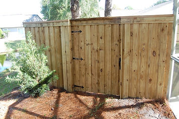 Vertical Board on Board Wood Fence Panels with Cap & Fascie , Matching Gate With Faux Hinges.