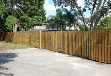 ^' Tall Vertical Shadow Box Wood Fence Panels with Matching 32' roll gate with wood panel facing.