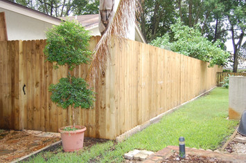 Vertical Stockade Wood Fence Panels With Matching Gate.
