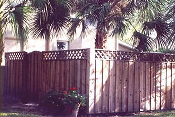 Board & Baton Wood Fence Panels with Ornamental Lattice and Round Top gate.