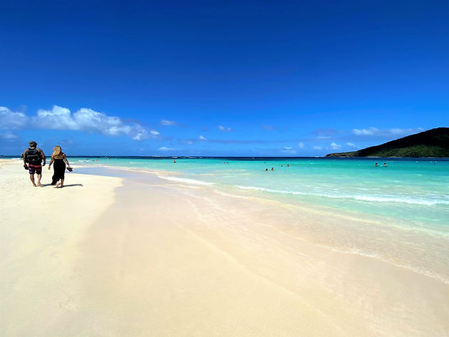 Walk by Flamenco Beach I VENTURES Day Tr