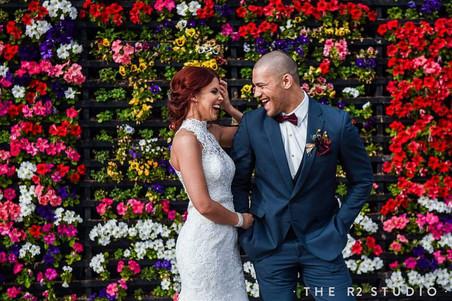 groom tux rental slate blue allure slim fit suit tuxedo groomsman flower wall burgundy bow tie  phoenix arizona