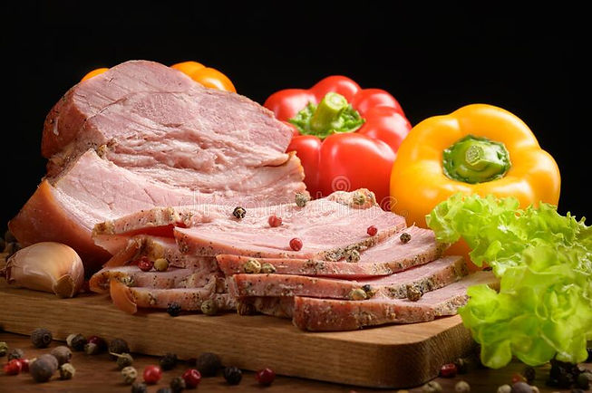 smoked-meat-sliced-wooden-table-addition