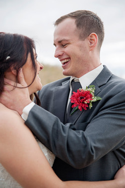 Regina Fall wedding, couple laughing and embracing