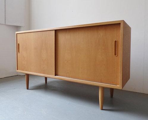Oak sideboard with sliding doors by Carlo Jensen for Hundevad & Co