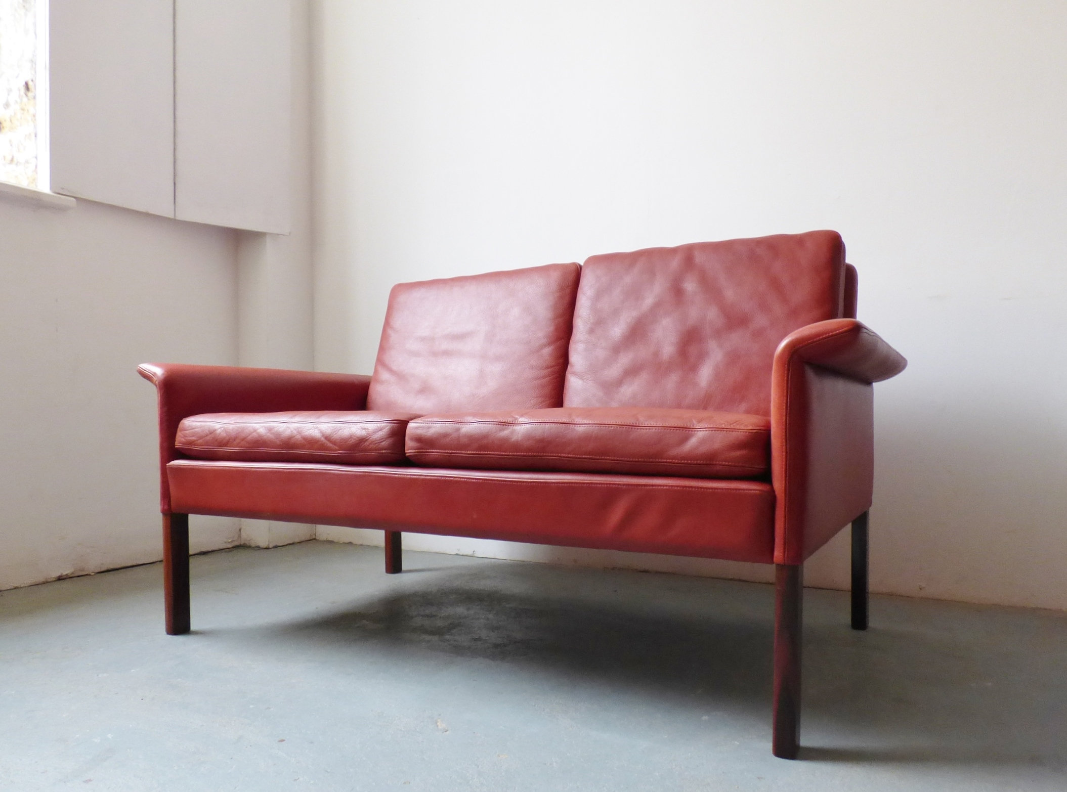 1960s red leather 2 seater sofa by Hans Olsen