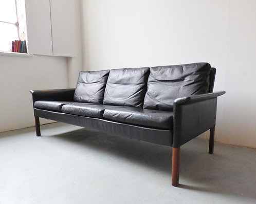 Black leather and rosewood sofa by Hans Olsen