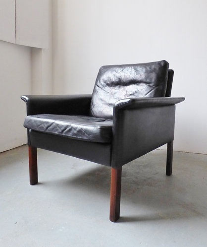 Black leather and rosewood armchair by Hans Olsen