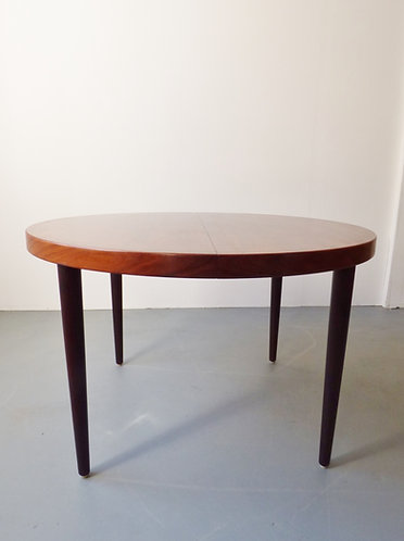 Extending rosewood dining table by Kai Kristiansen