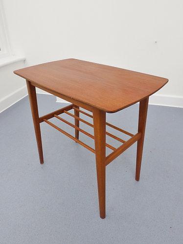1950s Danish side table with magazine shelf