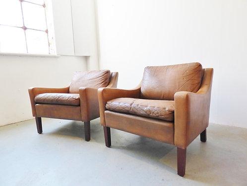 Mid-century Danish tan leather armchairs