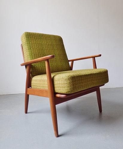 Danish teak lounge chair with green cushions