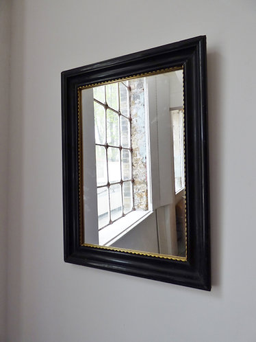 Antique black and gold mirror