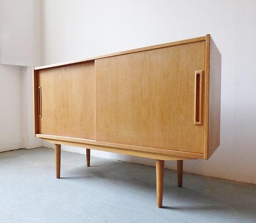 1970s Danish light oak sideboard with sliding doors