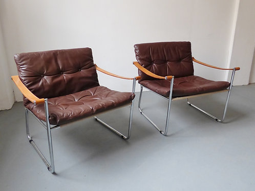 Pair of 1960s Danish chrome and leather lounge chairs
