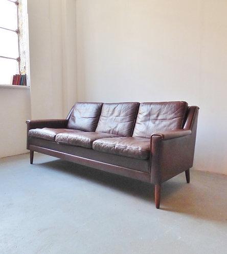 Mid-century Danish leather sofa with rosewood legs