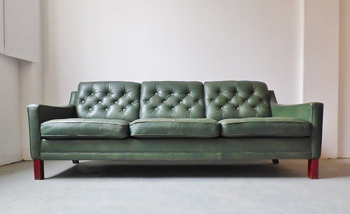 1960s Danish buttoned green leather sofa