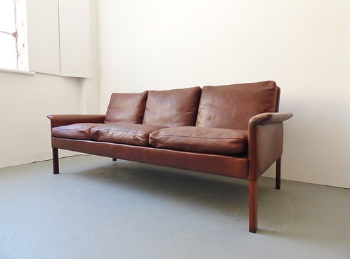 1960s brown leather and rosewood 3 seater sofa by Hans Olsen