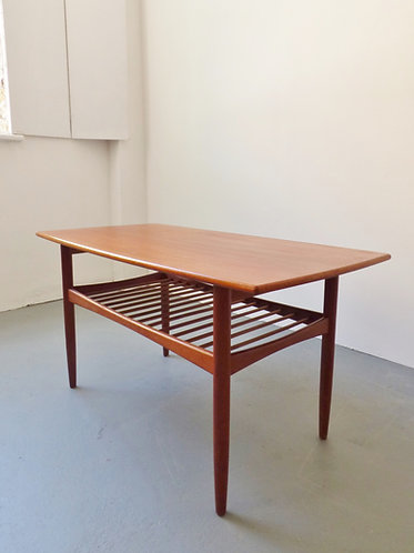 Mid-century Danish coffee table with magazine shelf