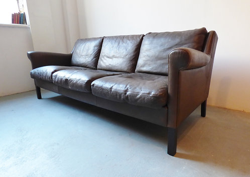 1960s Danish leather sofa with scroll arms