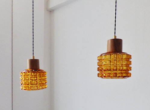 Pair of rosewood and amber glass pendant lights, 1960s