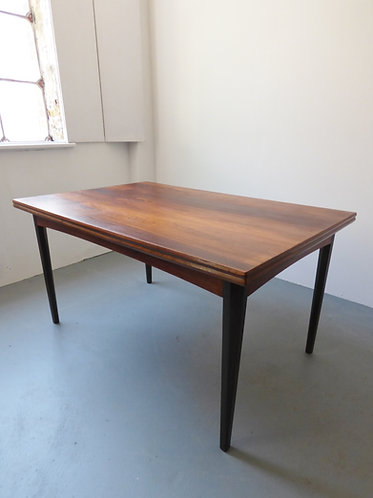 Extending rosewood dining table side view