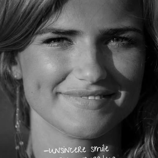 INSINCERE SMILE