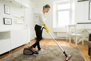 woman-in-casual-wear-vacuum-cleaning-the