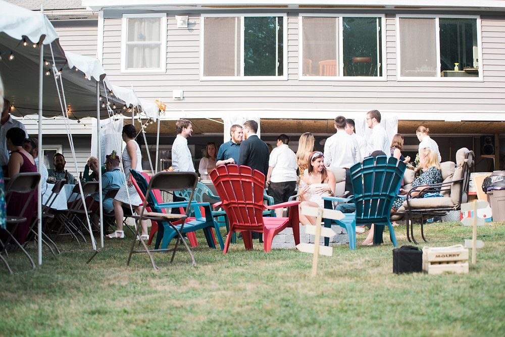 Adirondack chairs in a backyard wedding reception