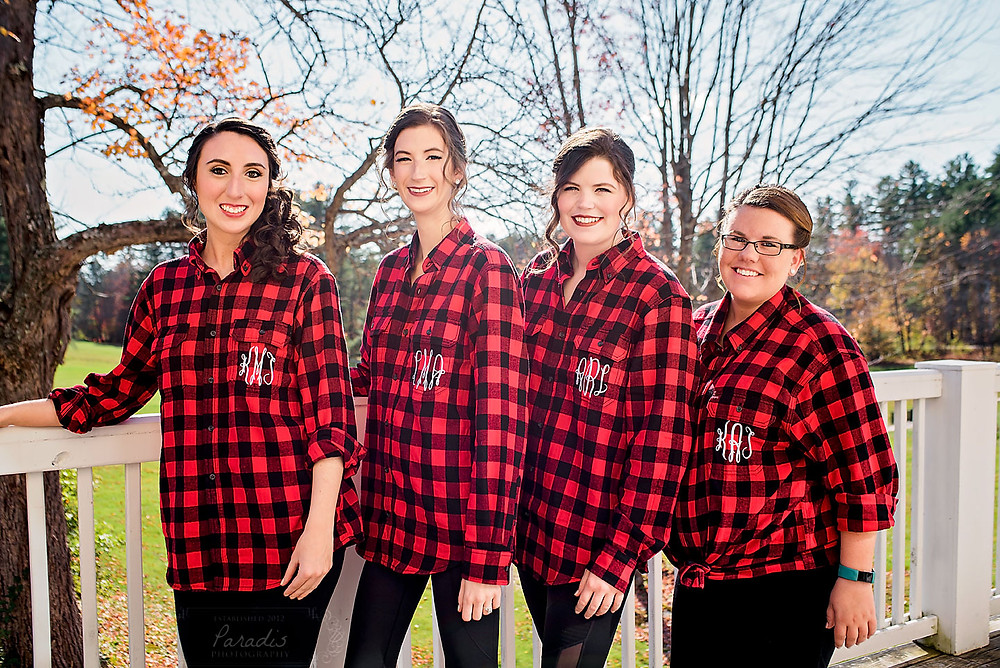 bride and bridesmaids wearing flannel before the wedding in bethel maine