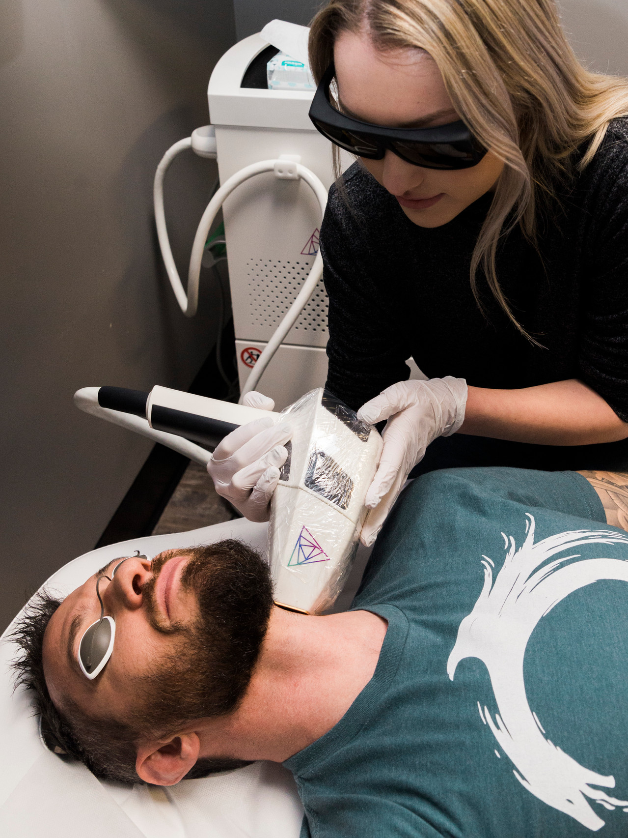Laser hair removal on man's neck