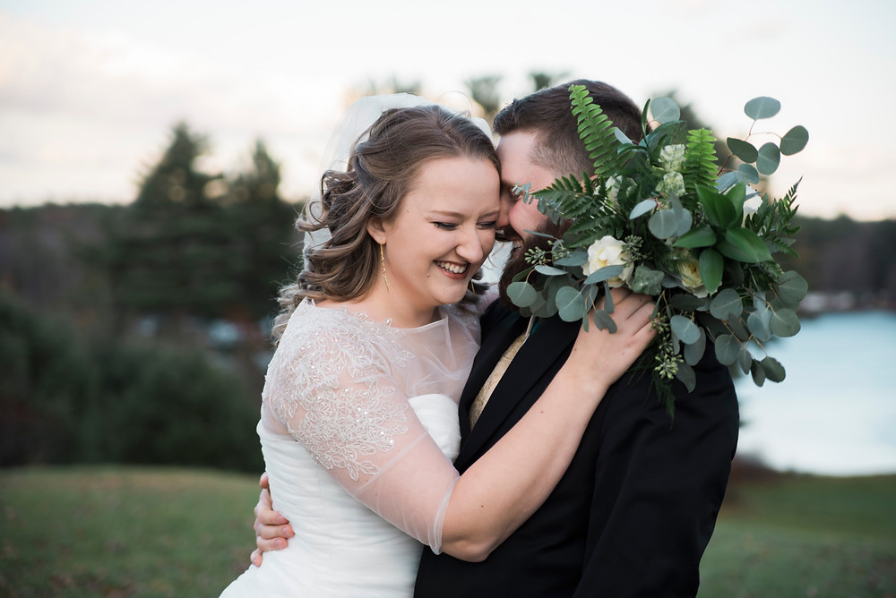 bride and groom at their november wedding in maine