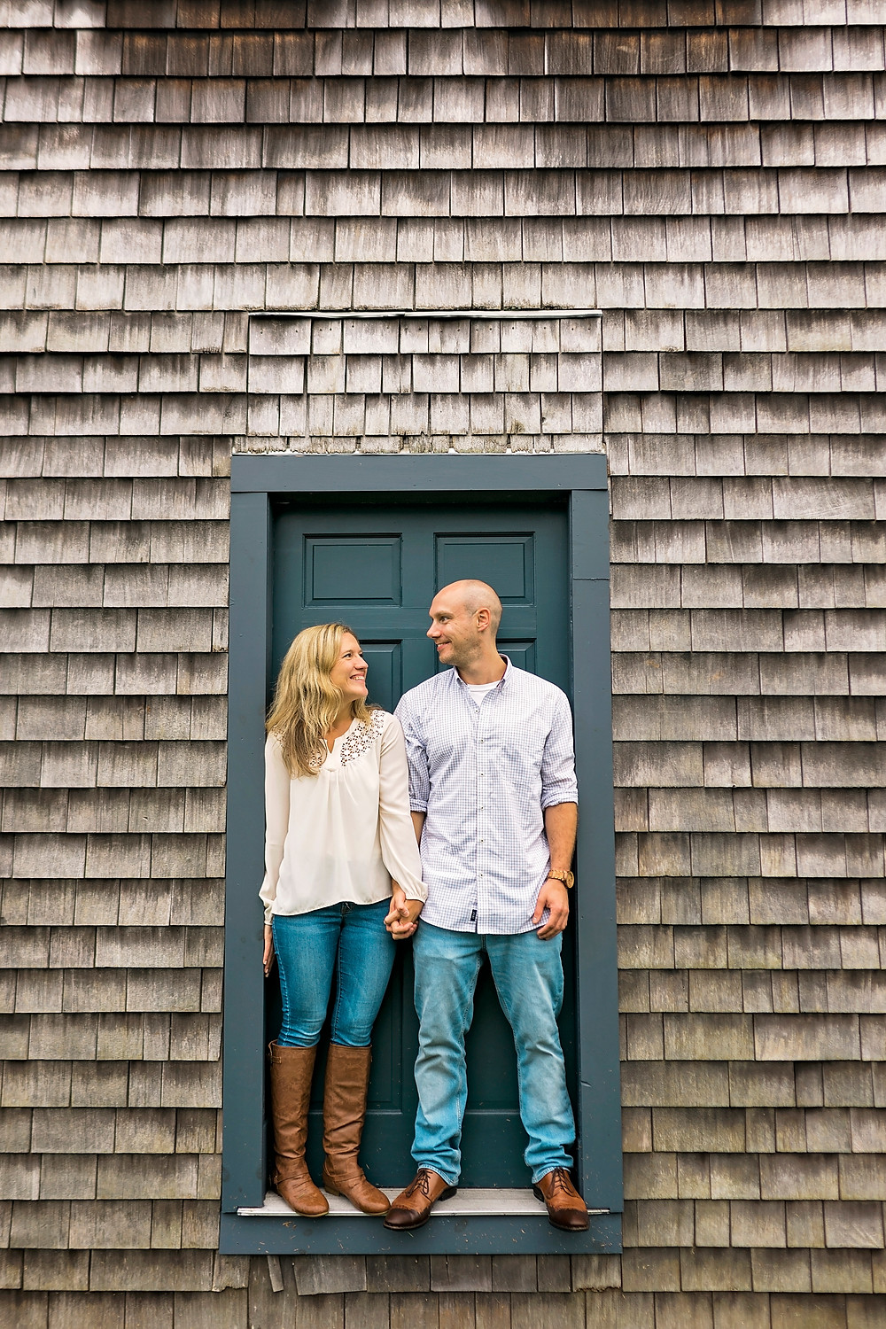 attached at the hip for their engagement session in portsmouth nh