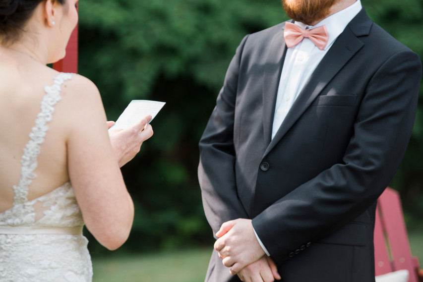 Bride holding her written vows during the cermeony