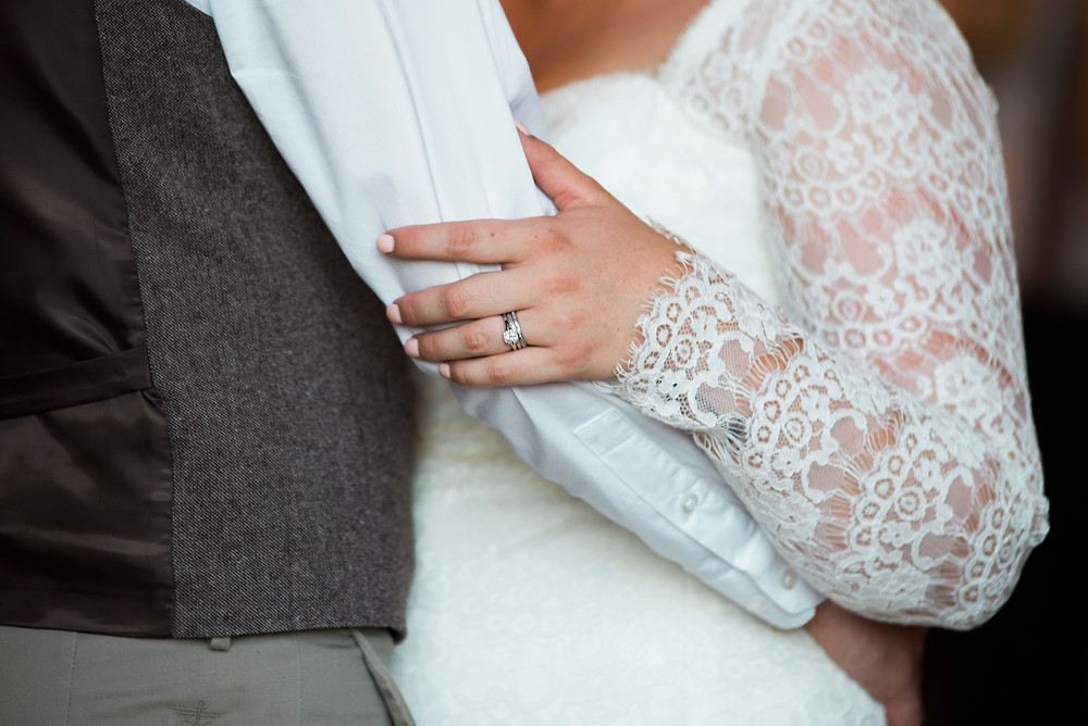 bride and groom embrace at their maine wedding at coolidge family farm in new gloucester