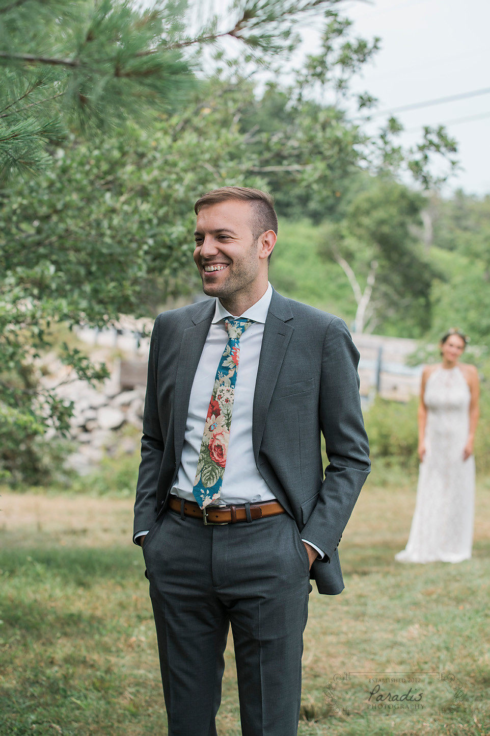Groom's reaction to his bride coming down for their first look