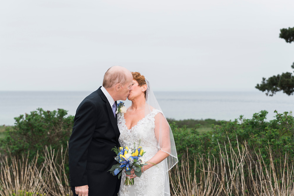 bride and groom kiss in kennebunkport maine weddings