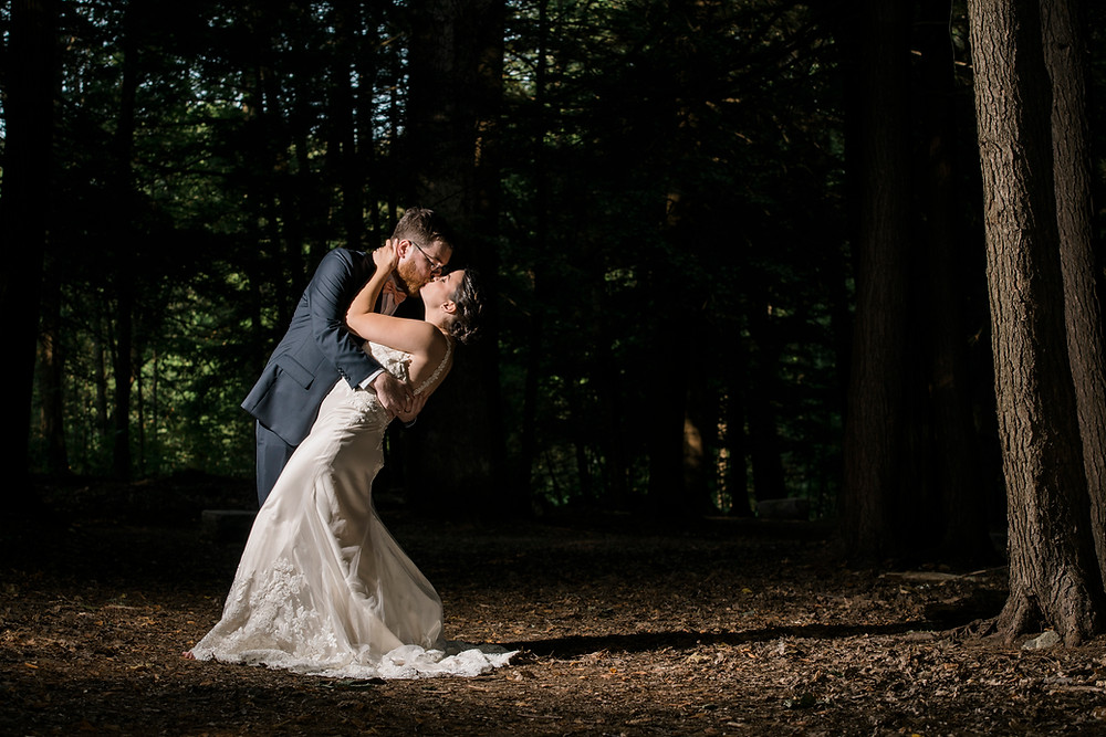 bride and groom in maine woods