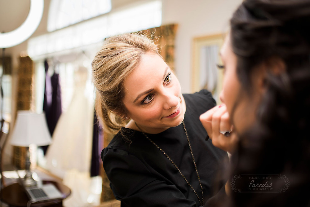 make up artist getting bride ready for her maine wedding