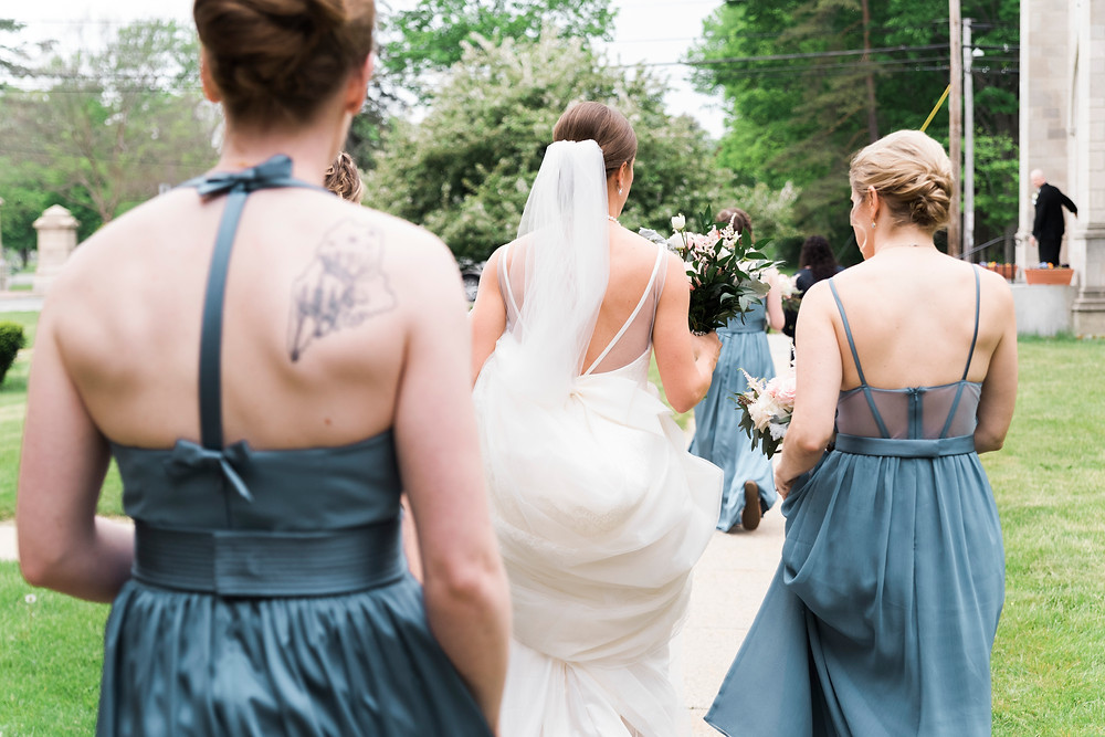 bride and bridesmaids on the way to the ceremony in portland maine
