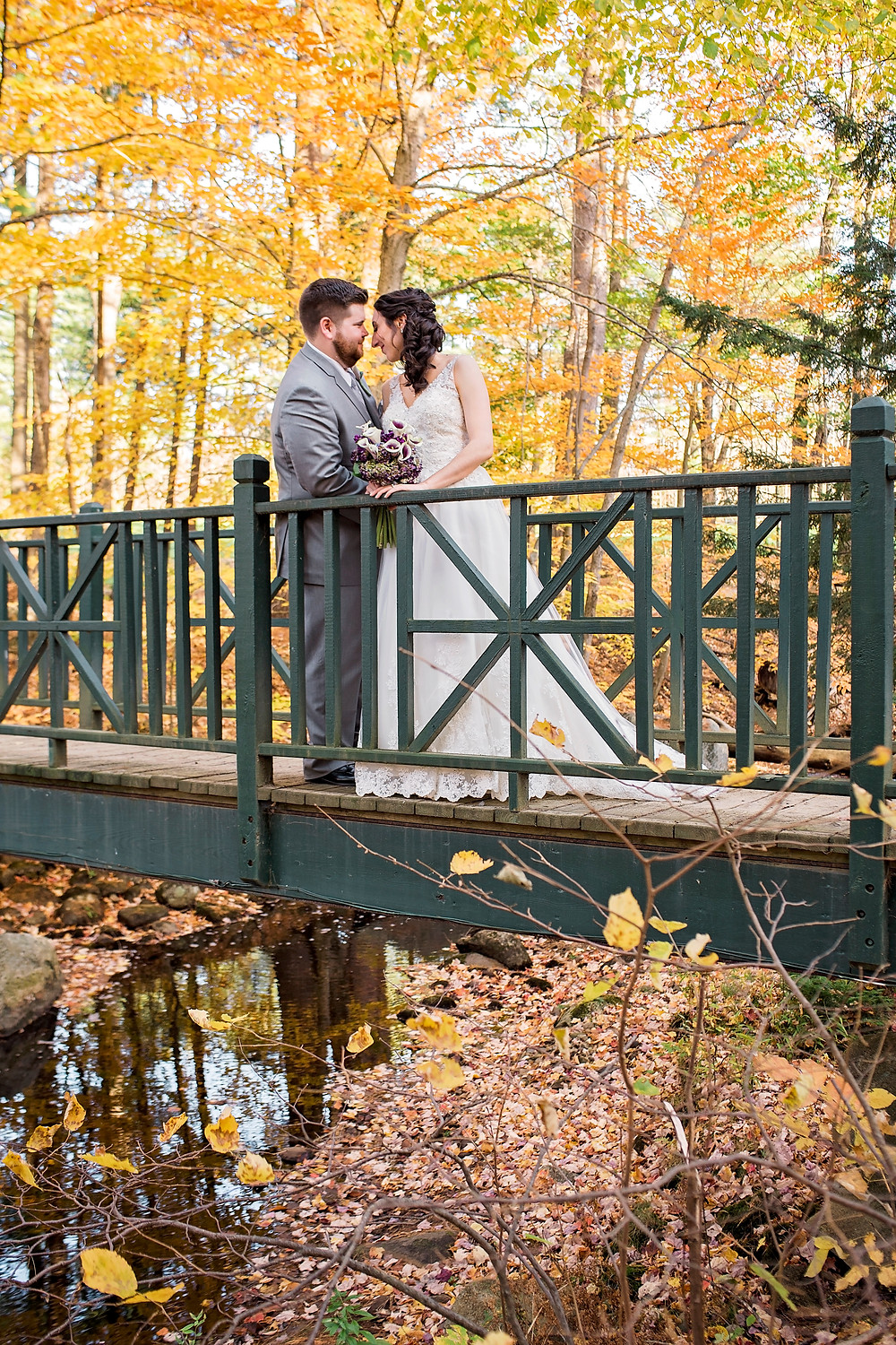 maine weddings have beautiful fall foliage with bride and groom