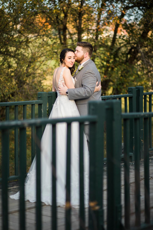 maine fall wedding bride and groom on a bridge at the bethel inn