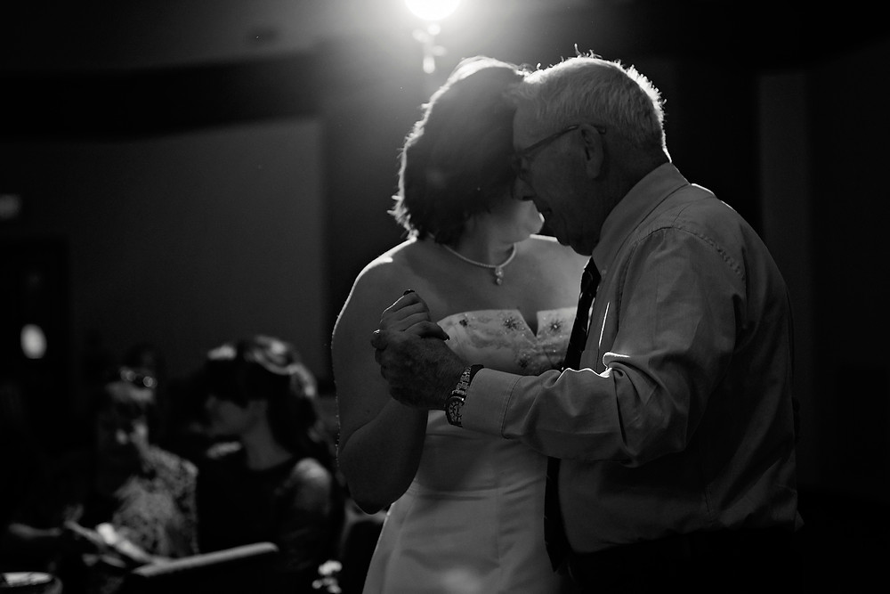 Bride and her grandfather dancing at her wedding